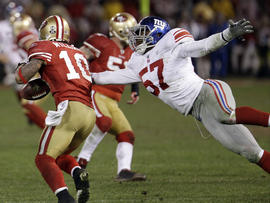 Kyle Williams fumbles as he is hit by Jacquian Williams