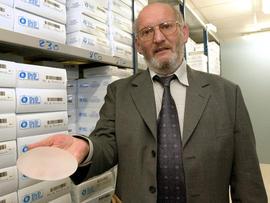 Former PIP President Jean-Claude Mas holds a breast implant