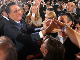 Former Massachusetts Gov. Mitt Romney greets supporters at a Super Tuesday night gathering with his family at the Westin Copley Place March 6, 2012, in Boston.
