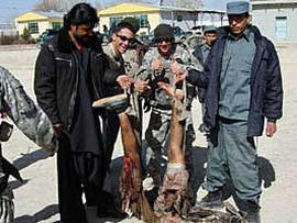 Soldiers from the Army's 82nd Airborne Division pose with the mangled corpose of a suicide bomber in Afghanistan's Zabol province. The image was first published in the LA Times, which received it from an unnamed soldier in the division.In this image provided to the LA Times by a soldier in the division.