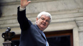 Former House Speaker Newt Gingrich waves to supporters as he leaves a campaign stop in Buffalo, N.Y., April 20, 2012.