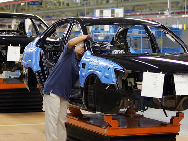 MONTGOMERY, UNITED STATES: Hyundai employees work on a car on the assembly line 20 May 2005 during the grand opening of their plant in Montgomery, AL. This is the South Korean car manufacturers first production plant in the US, capable of producing 300,000 cars a year. AFP PHOTO/ROBERT SULLIVAN (Photo credit should read ROBERT SULLIVAN/AFP/Getty Images)