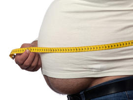 Measuring tape on large built man belly