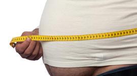 Measuring tape on large built man belly