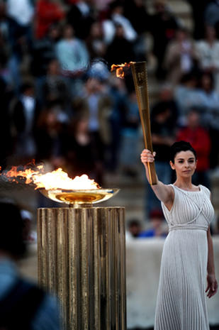 Olympic torch handed over to London