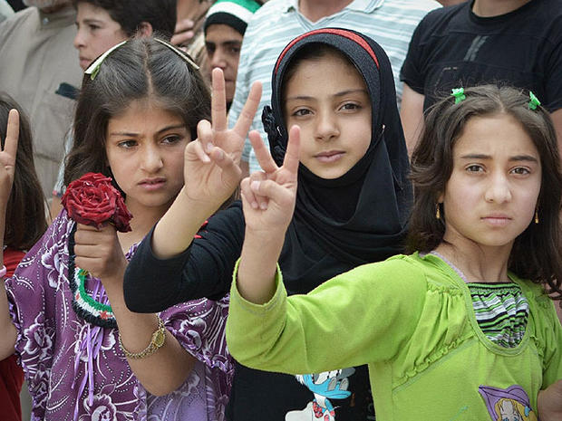 In this citizen journalism image taken on Tuesday, May 29, 2012 and provided by Edlib News Network ENN, Syrian girls flash victory signs during a demonstration in Kfarnebel, Idlib province, northern Syria.