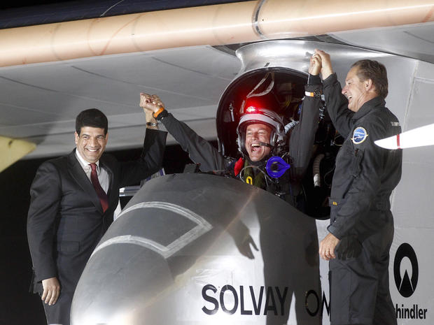 Solar Impulse pilots celebrate with a Moroccan solar energy official