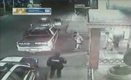 In this frame grab taken from video filmed by a surveillance camera on Jan 20, 2012, shows three men walk away from a hotel in their underwear with their hands tied behind their backs and some blindfolded, as they are led by men dressed in police uniforms toward police vehicles in Lagos de Moreno, Mexico.