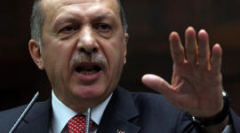 Turkish Prime Minister Recep Tayyip Erdogan addresses members of his Justice and Development Party at the parliament in Ankara, Turkey, June 26, 2012.