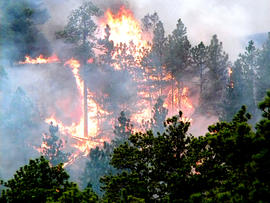 In this June 29, 2012, photo, a fire burns near Edgemont, S.D., after a mechanical problem on an RV caused the blaze.