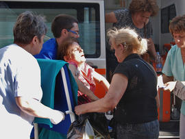 An unidentified injured Israeli tourist is carried in front of Borgas hospital after an explosion at Burgas airport, outside the Black Sea city of Burgas, Bulgaria.