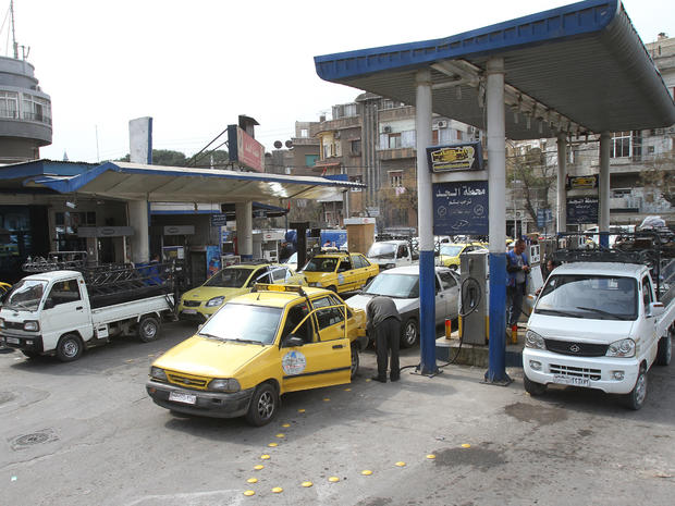 Vehicles line up at a gas station in Damascus