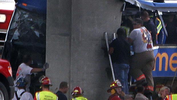 First responders work the scene of a Megabus crash on Interstate 55 near Litchfield, Ill., Aug. 2, 2012.