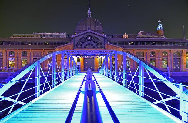 Light artist illuminates German city