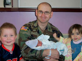 Capt. Michael McCaddon and his children.