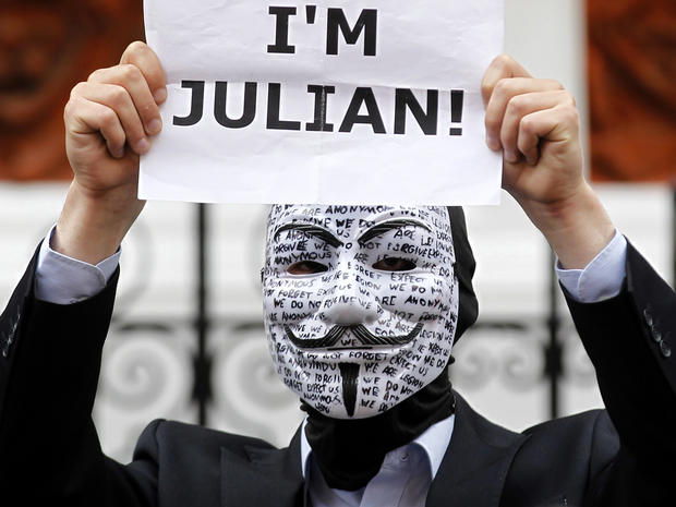 A supporter of WikiLeaks founder Julian Assange holds up a placard outside the Ecuadorian Embassy in London Aug. 16, 2012.