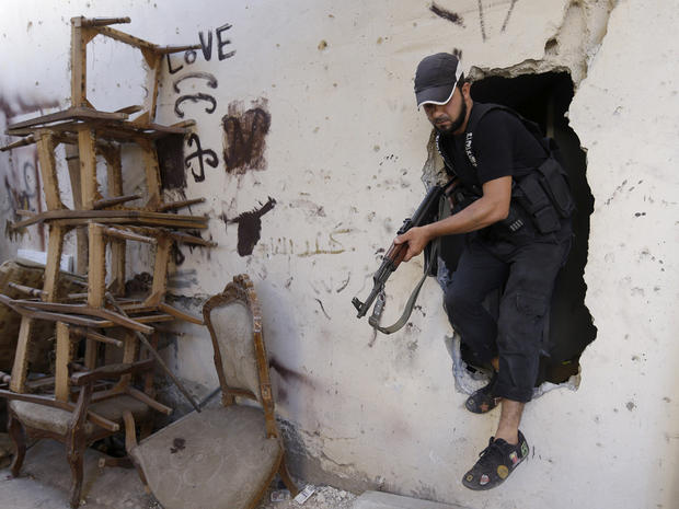 A Sunni gunman is seen during clashes in Tripoli, Lebanon