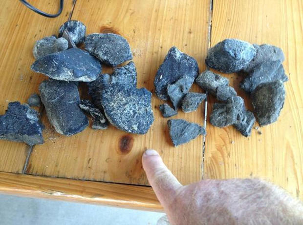 Tar balls that were discovered in the Grand Isle area by a local fisherman.  The Louisiana Department of Wildlife and Fisheries has closed off a section of the coast to fishing due to tar balls and a tar mat.