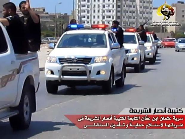 Militants from the Libyan Ansar al-Sharia group drive through Benghazi