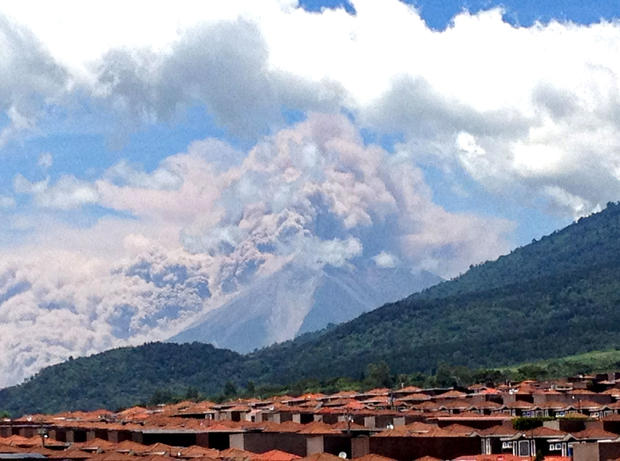 In this image captured on cell phone, plumes of smoke rise from the Volcan de Fuego or Volcano of Fire spews ash seen from Palin, south of Guatemala City, Thursday, Sept. 13, 2012.
