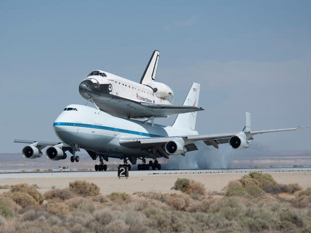 NASA's Shuttle Carrier Aircraft with the space shuttle Endeavour securely mounted on top touches down at Edwards Air Force Base after third leg of its four-segment final ferry flight from the Kennedy Space Center in Florida to Los Angeles International Airport on Sept. 20, 2012. The landing was preceded by a spectacular low-level flyby of NASA Dryden Flight Research Center and the Edwards flight line flown by NASA Dryden pilot Bill Brockett. Photo Credit: (NASA/Tom Tschida)