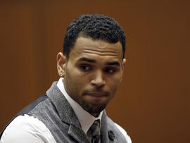 R&B singer Chris Brown in a Los Angeles courtroom on Monday, Sept. 24, 2012. Judge Patricia Schnegg has ordered a further review of Chris Brown's community service and travel to determine whether Brown has violated the terms of his probation for the 2009 beating of then-girlfriend Rihanna.
