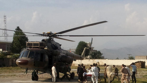 A wounded Pakistani girl, Malala Yousufzai, is moved to a helicopter.
