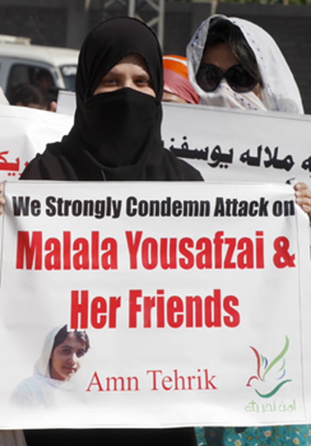 Pakistani protesters in Peshawar condemn the Taliban attack on schoolgirl Malala Yousufzai