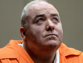 Michael Skakel looks up while listening to a statement from John Moxley, unseen, brother of victim Martha Moxley, in court in Middletown, Conn., Jan. 24, 2012.