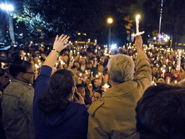 "Ole Miss Chancellor Dan Jones, right, and others raise their candles during the ""We are One Mississippi"" candlelight walk on the campus of the University of Mississippi in Oxford, Miss., Nov. 7, 2012. The walk was organized to condemn an election night protest against the re-election of President Obama."