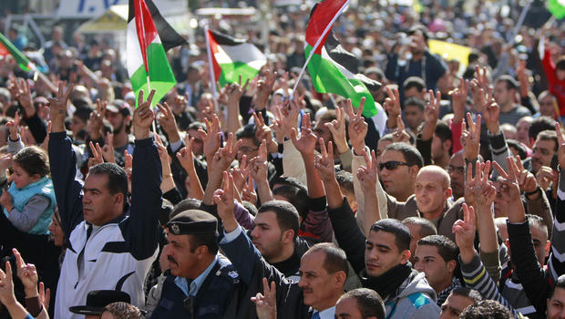 People wave Palestinian flags during a rally supporting the Palestinian UN bid for observer state status, in the West bank city of Ramallah, Thursday, Nov. 29, 2012.
