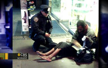 NYPD officer buys shoes for homeless man