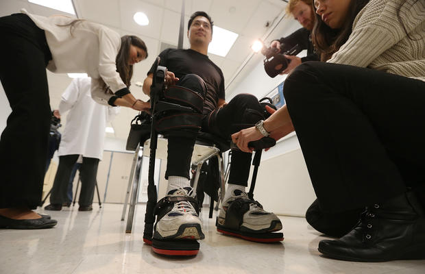 Robotic suit enables paraplegics to walk
