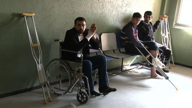 Wounded Syrians at Tishereen military hospital in norther Damascus, Syria.