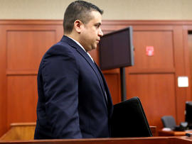 George Zimmerman arrives in court at the Seminole County courthouse for a hearing Dec. 11, 2012, in Sanford, Fla.
