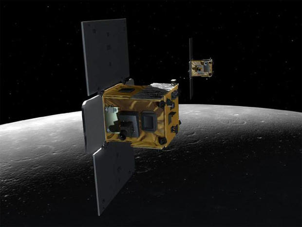 An artist's depiction of the twin spacecraft (Ebb and Flow) that comprise NASA's Gravity Recovery And Interior Laboratory (GRAIL) mission.