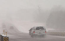 Christmas storm cancels flights, shuts down roads