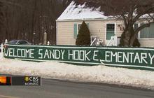Newtown massacre survivors return to school