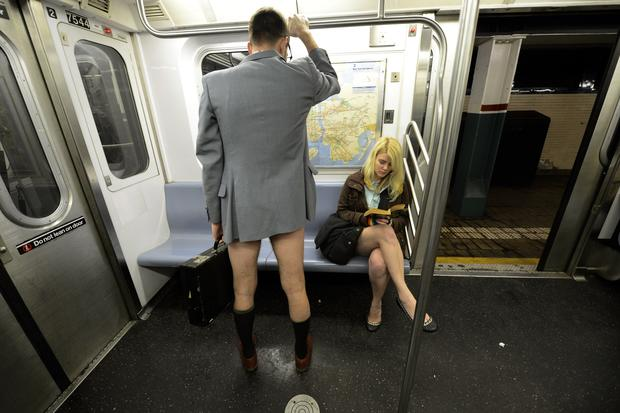 Riders strip on NYC subways