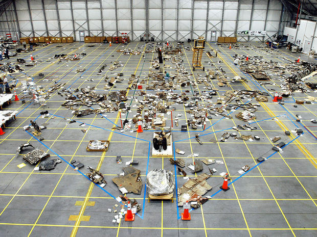 In this NASA handout, Columbia Space Shuttle debris lies floor of the RLV Hangar May 15, 2003 at Kennedy Space Center, Florida. The Columbia Accident Investigation Board investigators say that a culture of low funding, strict scheduling and an eroded safety program at NASA doomed the flight of the space shuttle. (Photo by NASA/Getty Images)