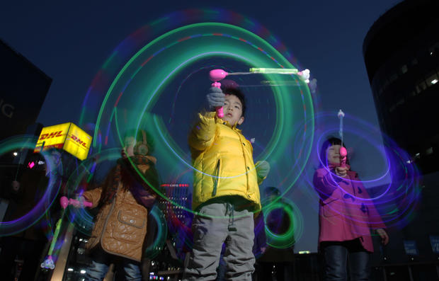 South Koreans illuminate the streets of Seoul