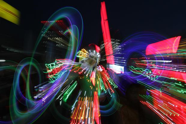 South Koreans illuminate the streets of Seoul