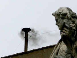 Black smoke rises from the Sistine Chapel chimney during the 2005 conclave.