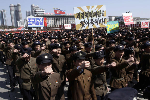 North Koreans march through Kim Il Sung Square
