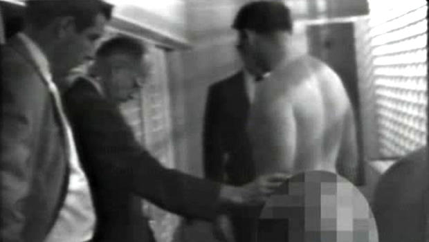 James Earl Ray, the man who assassinated Martin Luther King in 1963, is stripped search by police.