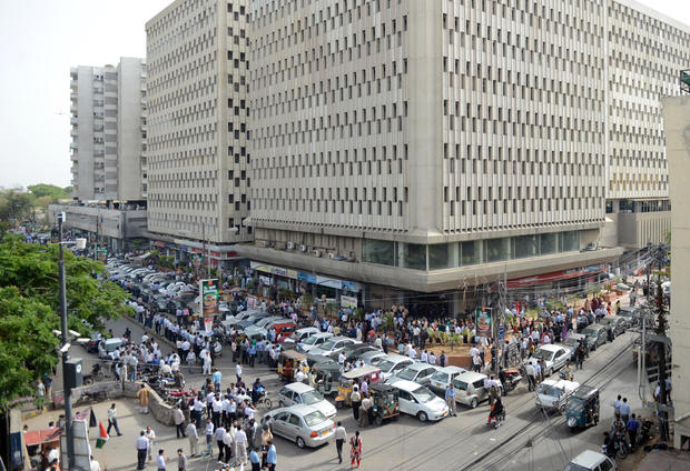 Pakistanis evacuated from buildings in Karachi following a massive earthquake centered in neighboring Iran