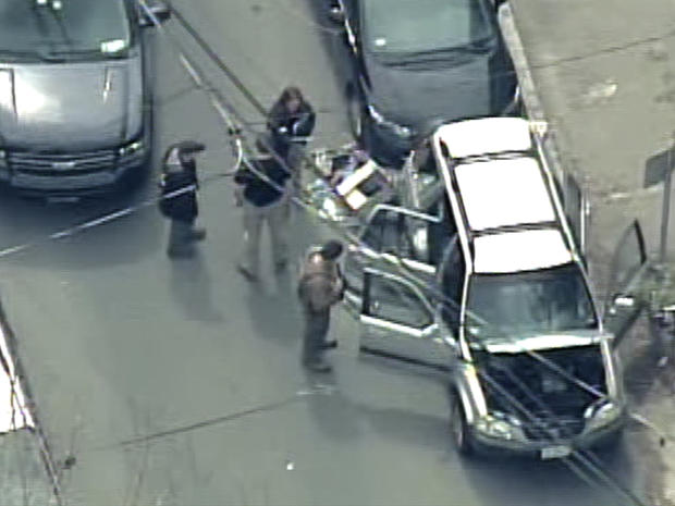 Abandoned vehicle after carjacking by Boston bombing suspect.