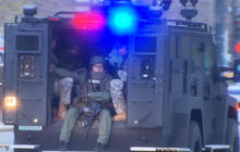 Boston on high alert as one bombing suspect is still at large