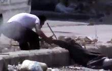 Syrian man steps into crossfire to save elderly man