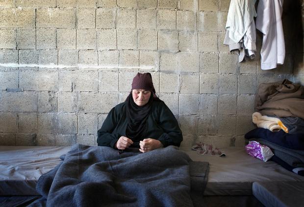 Hamdah, 70, trapped in her hut at the Zaatari camp